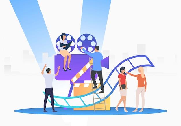 Mitarbeiter schaffen film Kostenlosen Vektoren