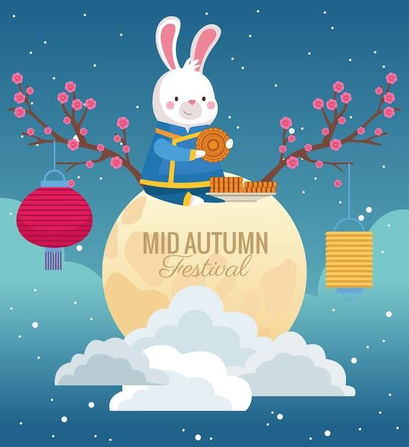 Mittherbstfeierkarte mit kaninchen im vollmond Premium Vektoren