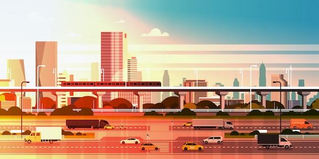 Moderne stadt über sonnenuntergangillustration stadtbild mit landstraßen-straße und u-bahn über wolkenkratzer-gebäuden Premium Vektoren