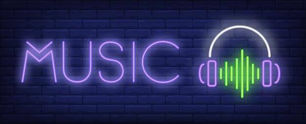 Musikneontext mit kopfhörern und schallwelle Kostenlosen Vektoren