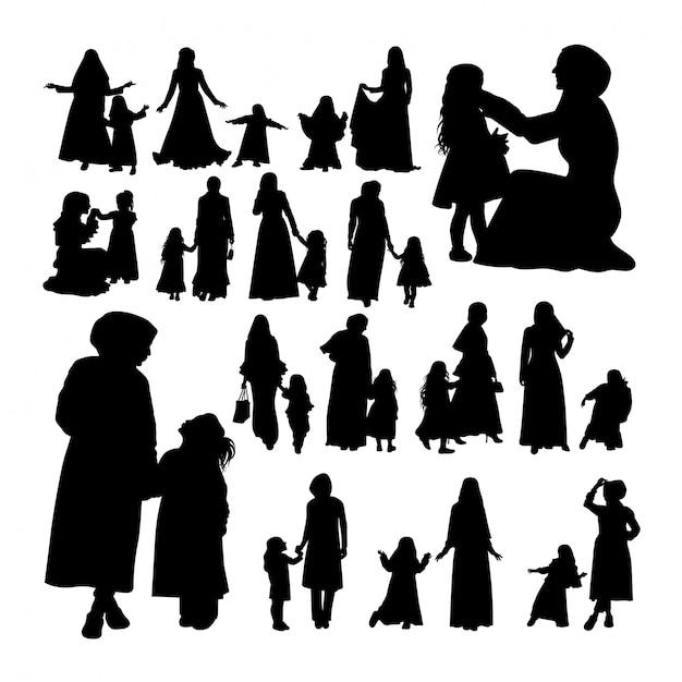 Muslimische mutter und kind silhouetten. Premium Vektoren