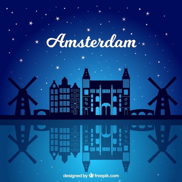 Nacht skyline von amsterdam Kostenlosen Vektoren
