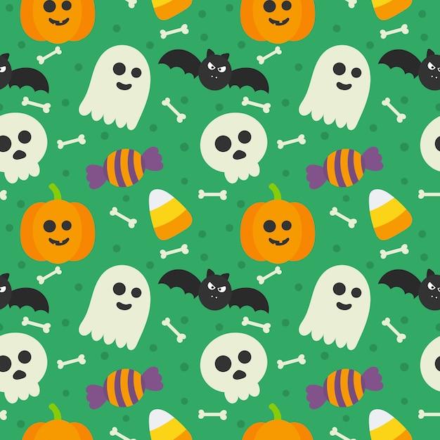 Nahtlose muster glücklich halloween icons isoliert auf grün. Premium Vektoren