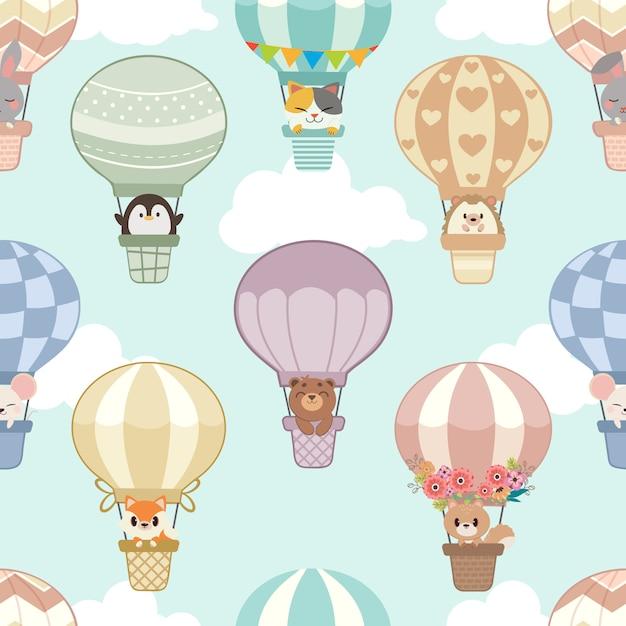 Nahtloses muster des heißluftballons mit tieren auf dem himmel und der wolke. Premium Vektoren