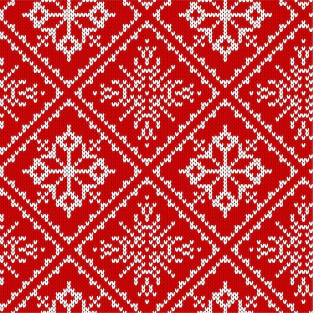 Nahtloses muster des weihnachtsstrickens mit schneeflocken. Premium Vektoren