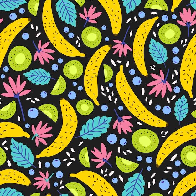 Nahtloses muster mit exotisch blühenden blumen und tropischen früchten. Premium Vektoren