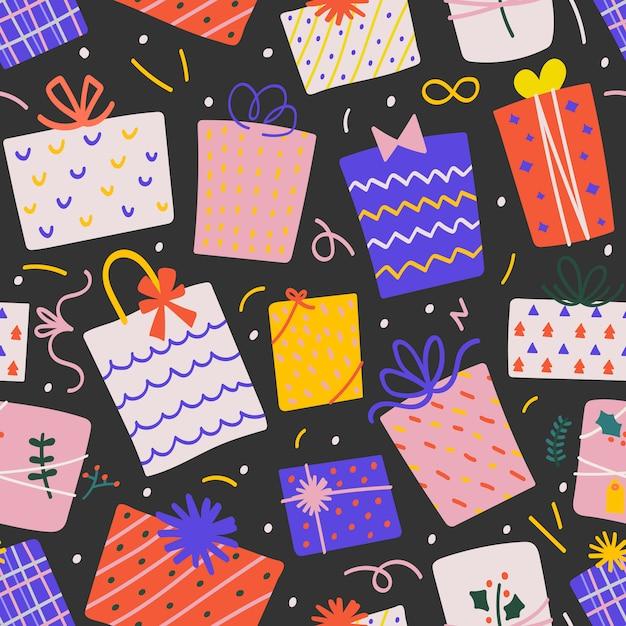 Nahtloses vektormuster mit weihnachtsgeschenkboxen Premium Vektoren