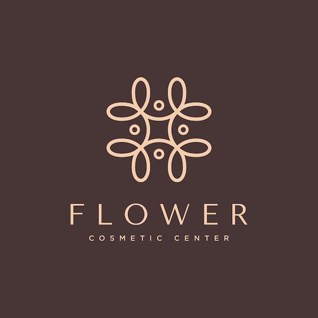 Natürliches kosmetisches logo mit einem schönen blumenkonzept Premium Vektoren