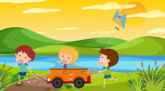 Naturszene mit den kindern, die im park spielen Premium Vektoren