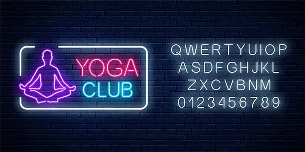 Neon leuchtendes zeichen des yogaübungsclubs im rechteckrahmen mit alphabet auf dunkler backsteinmauer Premium Vektoren
