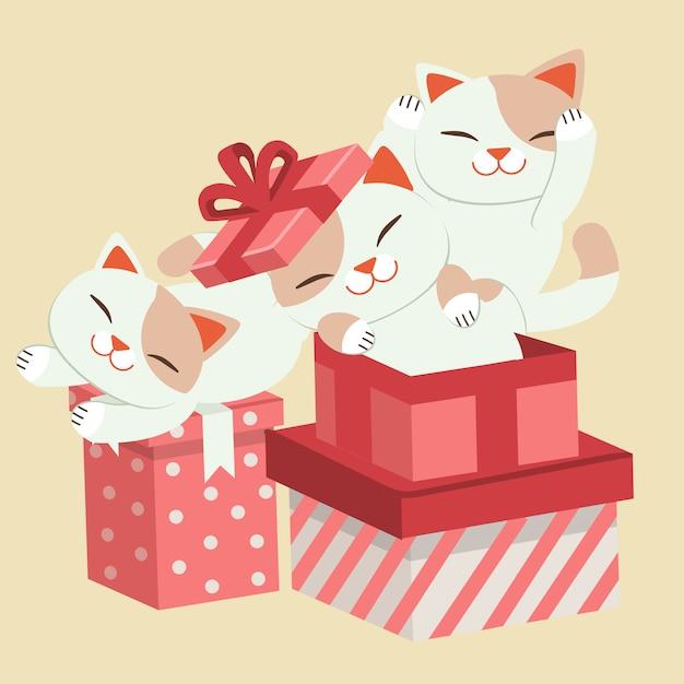 Nette katze, die mit einer geschenkboxillustration spielt Premium Vektoren