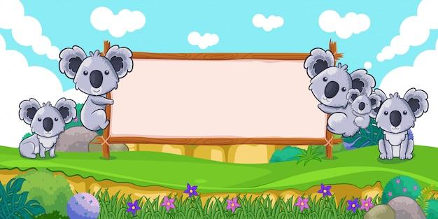 Nette koala mit einem leeren zeichenholz Premium Vektoren