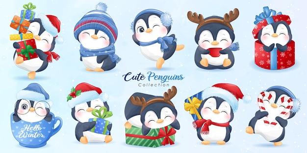 Nette pinguine stellten für weihnachtstag mit aquarellillustration ein Premium Vektoren