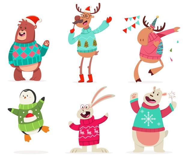Nette tiere auf der party in einem hässlichen weihnachtspullover Premium Vektoren