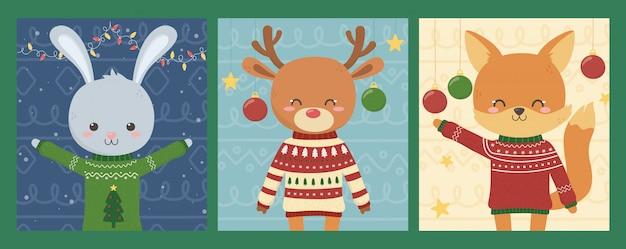 Nette tiere der feier der frohen weihnachten mit hässlichen strickjacken Premium Vektoren