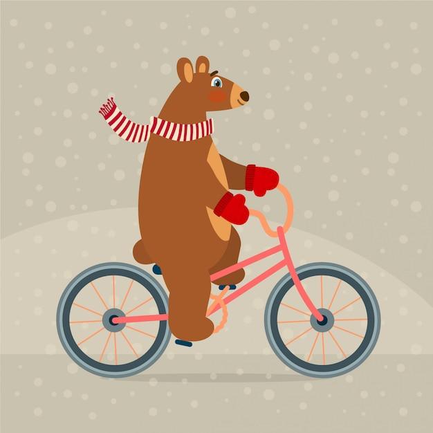 Netter bär auf dem fahrrad Premium Vektoren
