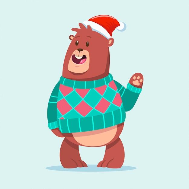 Netter bär in einem lustigen tiercharakter der hässlichen weihnachtsstrickjacken-karikatur an lokalisiert. Premium Vektoren