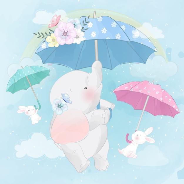 Netter elefant und häschen, die mit regenschirm fliegt Premium Vektoren