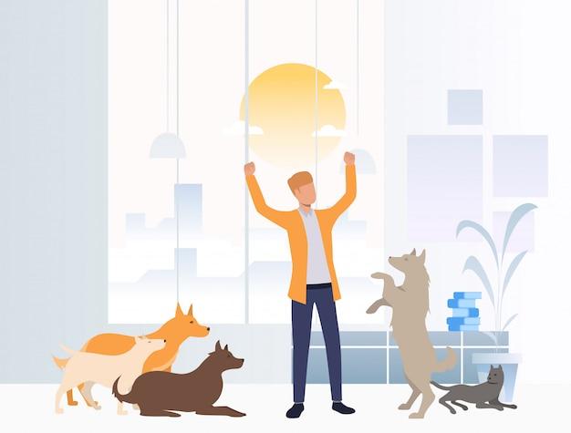 Netter freiwilliger, der um hunden im tierheim sich kümmert Kostenlosen Vektoren