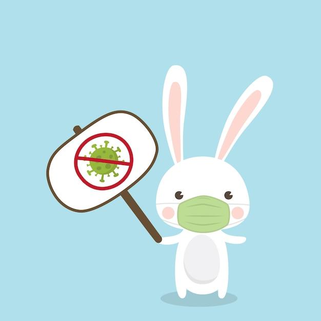 Netter kaninchencharakter, der medizinische maske auf himmelblauem hintergrund trägt. abbildung des coronavirus (covid-19). Premium Vektoren