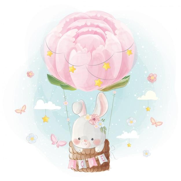 Netter kleiner bunny flying mit pfingstrosen-ballon Premium Vektoren