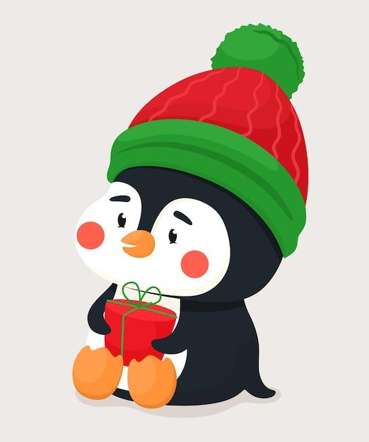 Netter kleiner pinguin mit einem geschenk und in einem warmen hut. vektorfigur im flachen karikaturstil. Premium Vektoren