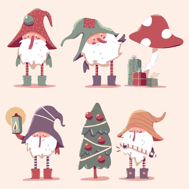 Netter weihnachtszwergkarikaturcharakter gesetzt Premium Vektoren