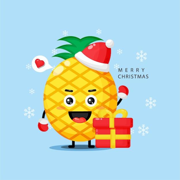 Nettes ananasmaskottchen, das weihnachtstag feiert Premium Vektoren