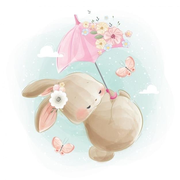 Nettes baby bunny flying mit pinky umbrella Premium Vektoren