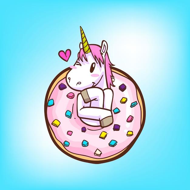 Nettes einhorn und donuts Premium Vektoren