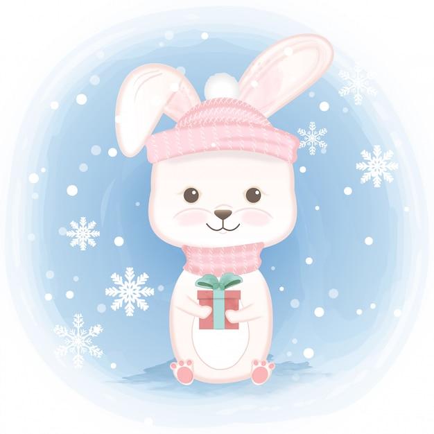 Nettes kaninchen, das geschenkbox hält Premium Vektoren