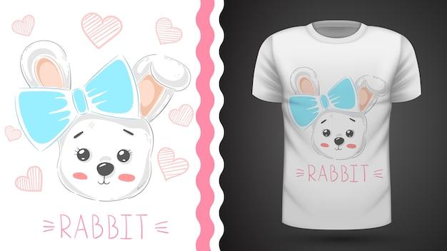 Nettes kaninchen mit herzen - idee für druckt-shirt Premium Vektoren