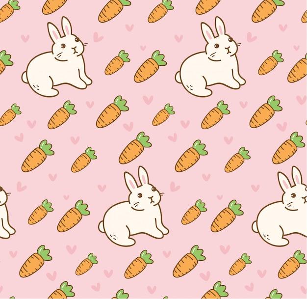 Nettes kaninchen mit nahtlosem muster der karotte Premium Vektoren
