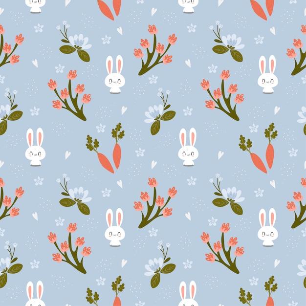 Nettes kaninchen mit nahtlosem muster der karotten- und vielzahlblume Premium Vektoren