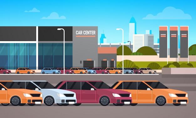 Neuwagen über autohaus-ausstellungsraum-gebäude Premium Vektoren