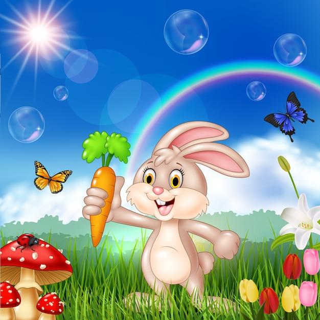 Niedliches kaninchen der karikatur, das eine karotte anhält Premium Vektoren