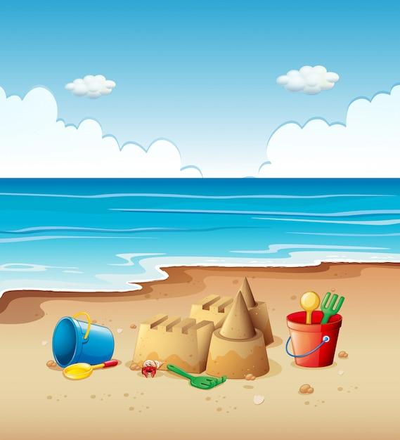 Ocean szene mit spielzeug am strand Kostenlosen Vektoren
