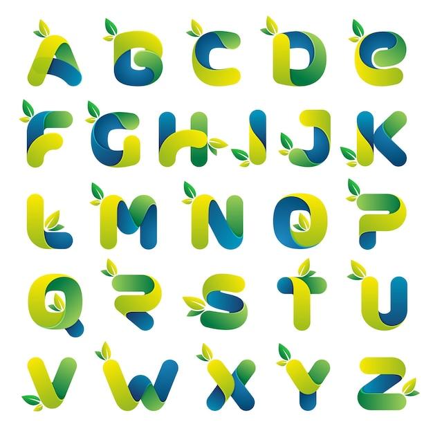 Ökologisches alphabet mit grünen blättern. schriftstil Premium Vektoren