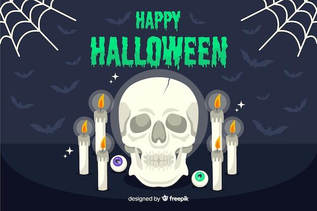 Okkultistischer schädel und kerzen halloween-hintergrund Kostenlosen Vektoren