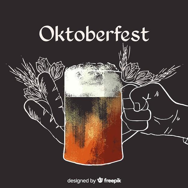 Oktoberfest-konzept mit hand gezeichnetem hintergrund Kostenlosen Vektoren