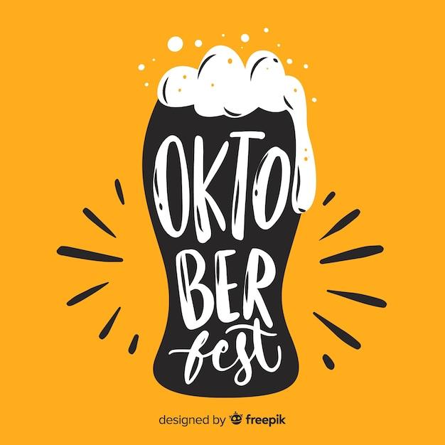 Oktoberfest-schriftzug mit gelbem hintergrund Kostenlosen Vektoren