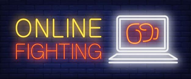 On-line-kämpfender neontext mit boxhandschuh auf laptopbildschirm Kostenlosen Vektoren