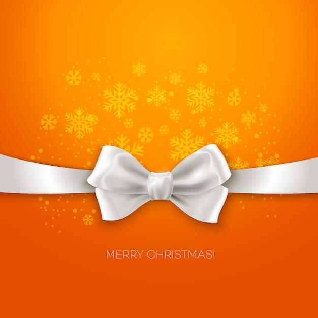Orange weihnachtsgrußkarte mit band mit weißem silk bogen Premium Vektoren