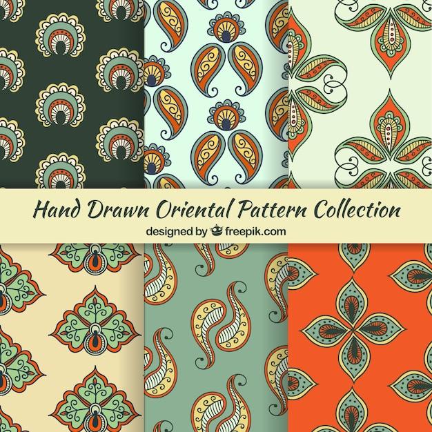 Orientalische muster sammlung von floralen paisley Kostenlosen Vektoren