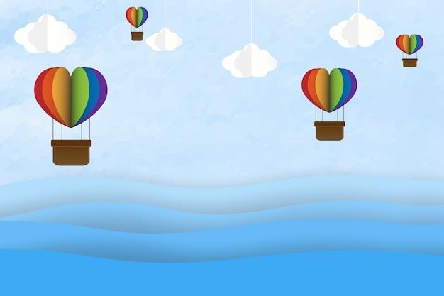 Origami machte bunten heißluftballon in einem herzen mit formfall auf himmel Premium Vektoren