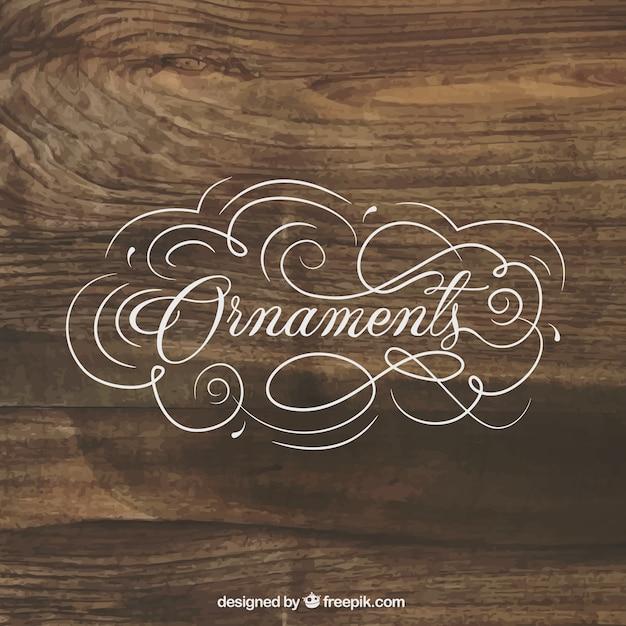 ornaments schriftzug auf holz hintergrund download der kostenlosen vektor. Black Bedroom Furniture Sets. Home Design Ideas