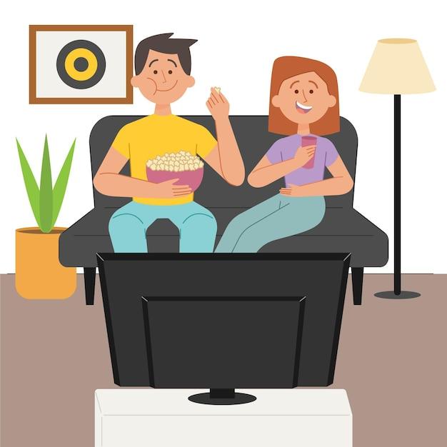 Paar, das popcorn isst und einen film sieht Kostenlosen Vektoren