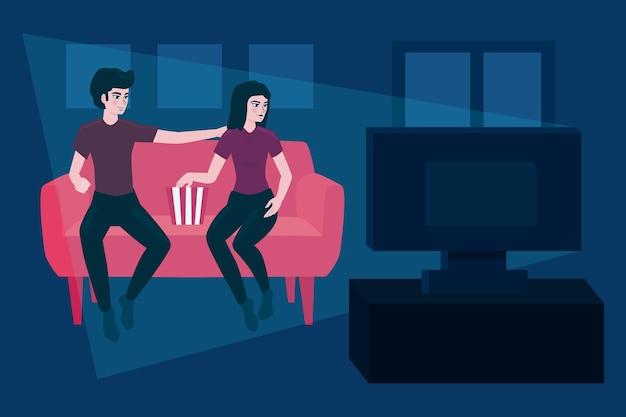 Paar, das zu hause einen film sieht Kostenlosen Vektoren