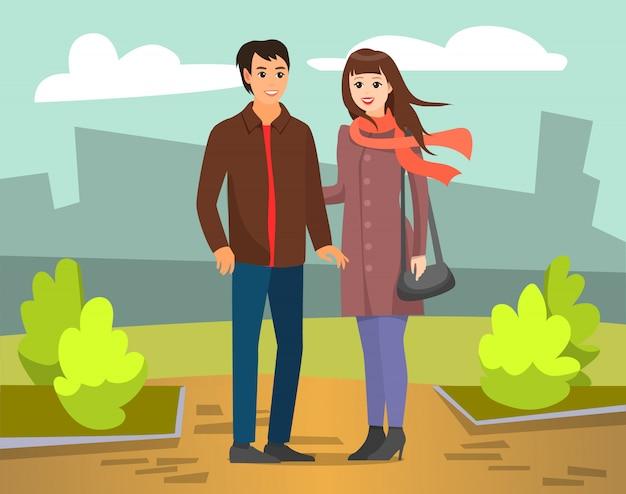 Paar-mann und frau, die in autumn city park gehen Premium Vektoren