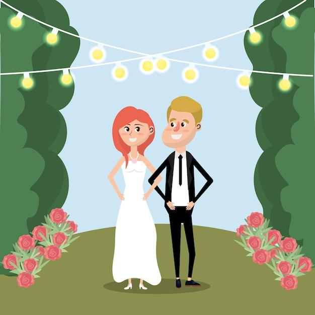 Paar mit blumen und lichtern verheiratet Premium Vektoren